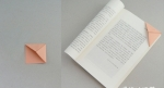 These corner bookmarks are so handy...they fit snugly onto the page corner, and do not protrude above the page so are less likely to fall out. (when my oldest daughter was a toddler she loved pulling out my bookmarks!...not these ones though!) instructions at http://www.origami-guide.com/origami-bookmarks.html